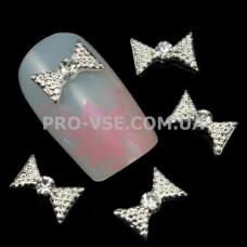 Бант серебро с камнем